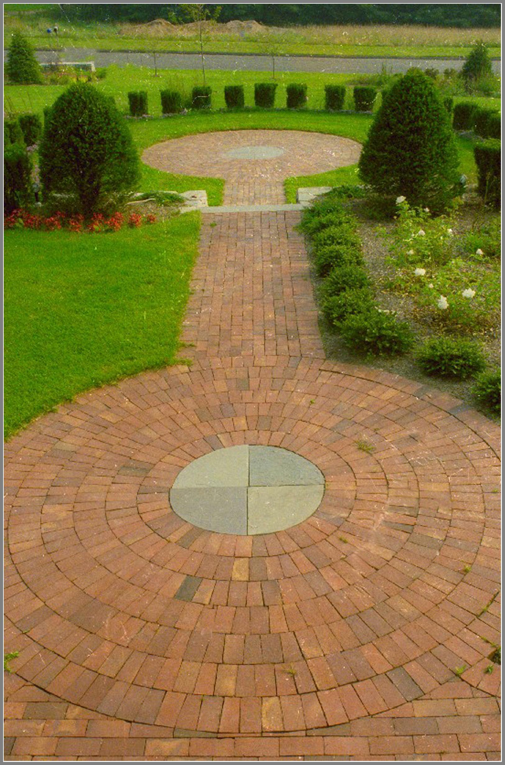 Brick walkway inlays with blue stone.