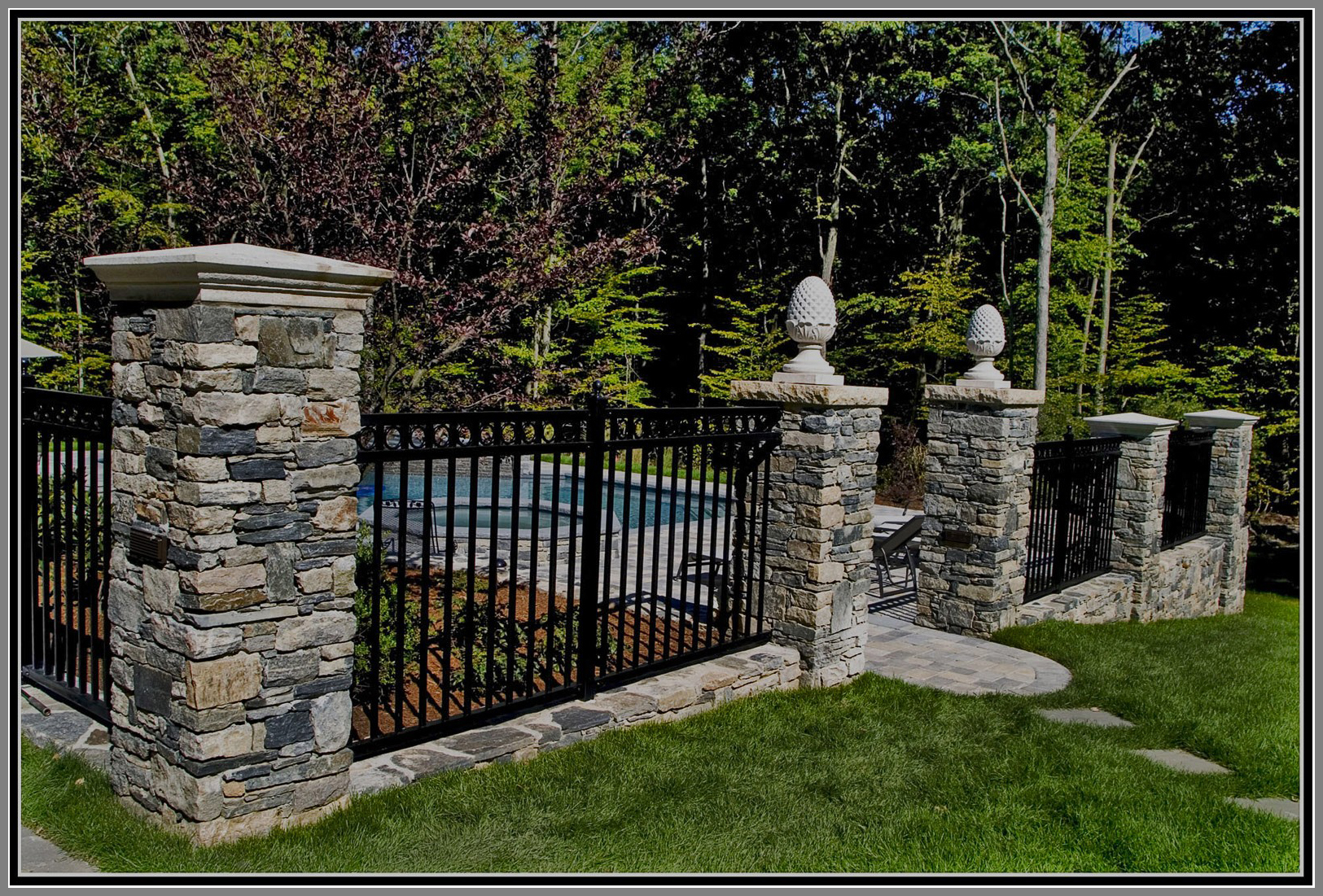 Aluminium Fence with stone columns by Artistic Outdoors