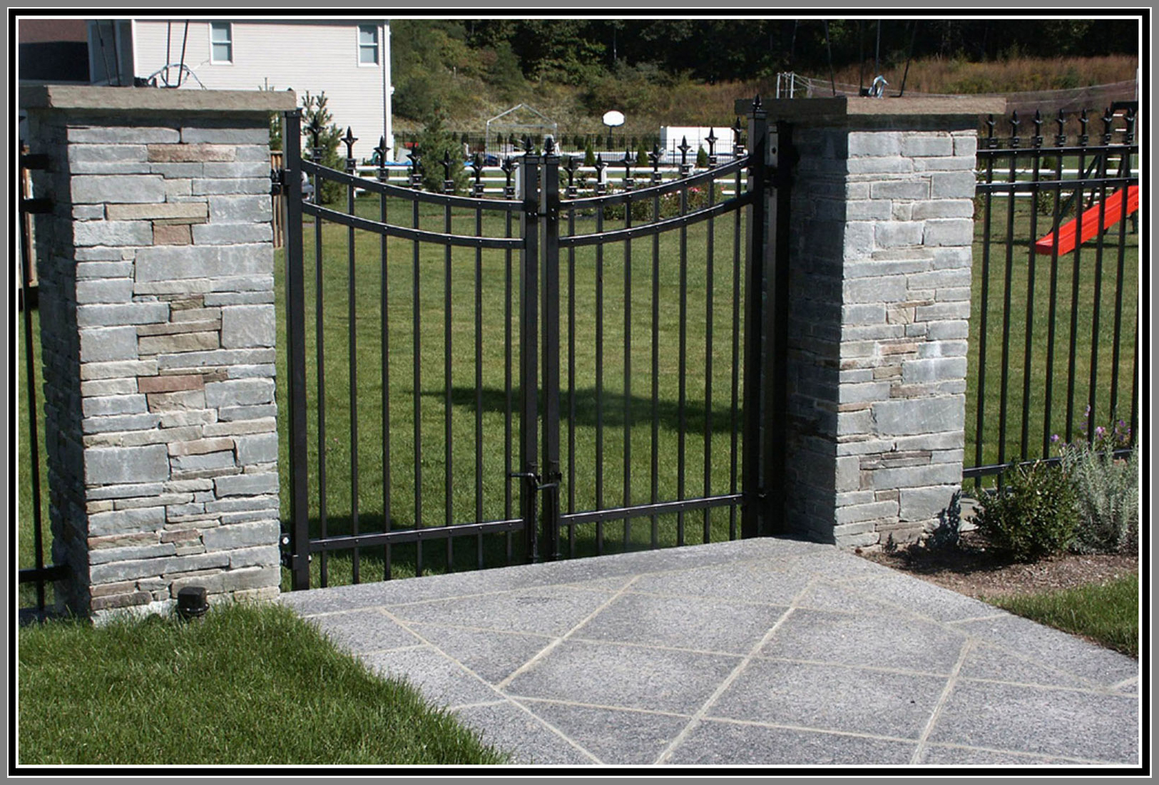 Aluminium fence and gate with stone columns
