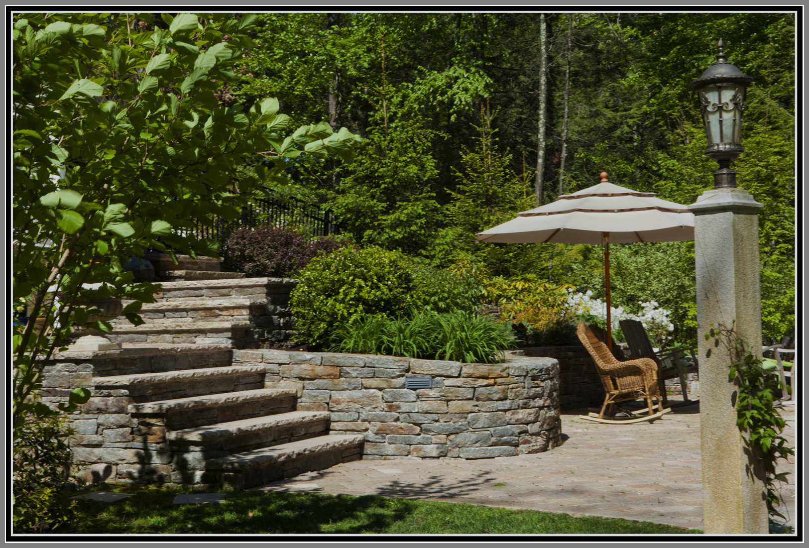 Terrace garden with stone walls and steps by Artistic Outdoors