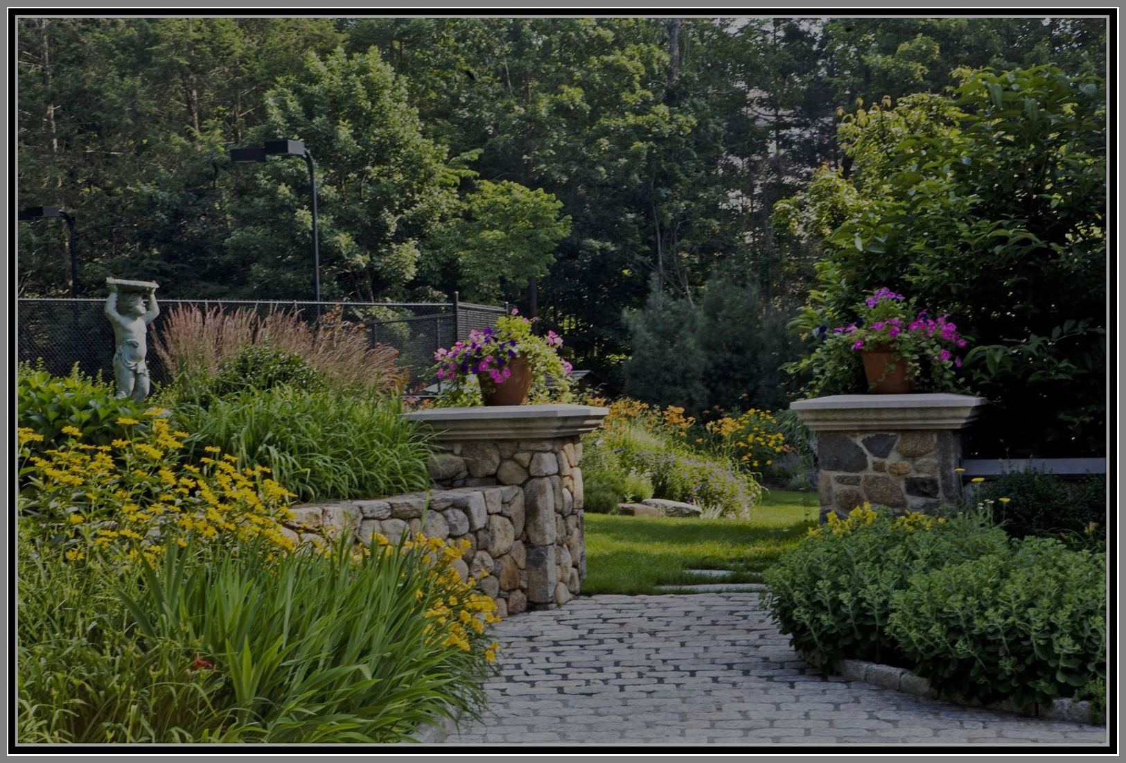 Garden with Urns/ ornaments by Artistic Outdoors
