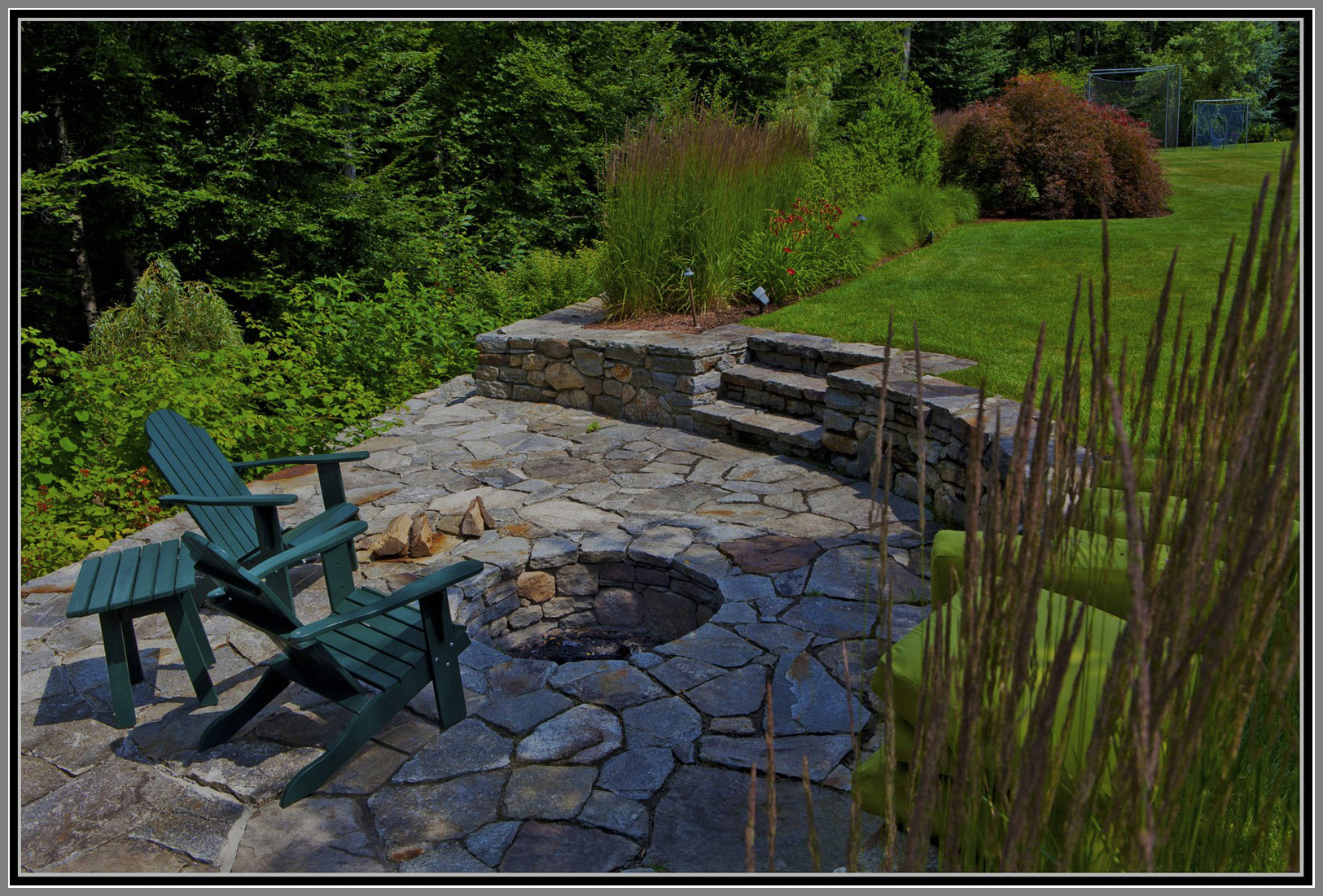 Inground stone fire pit by Artistic Ourtdoors