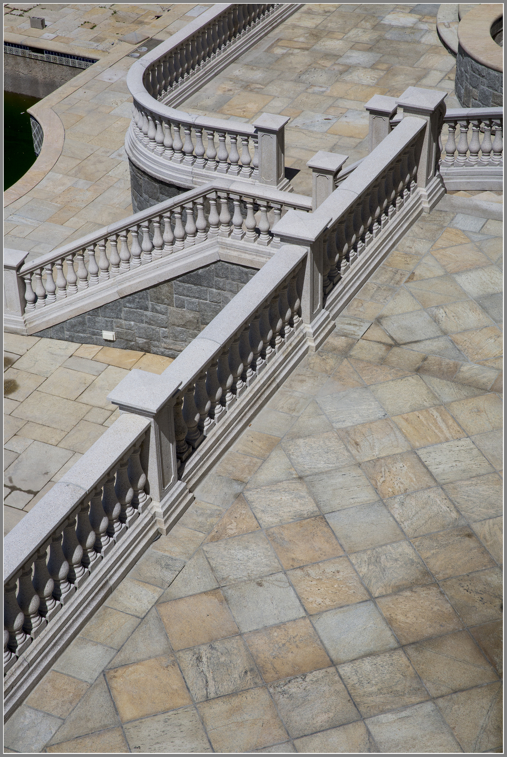 Granite balustrade system and patio