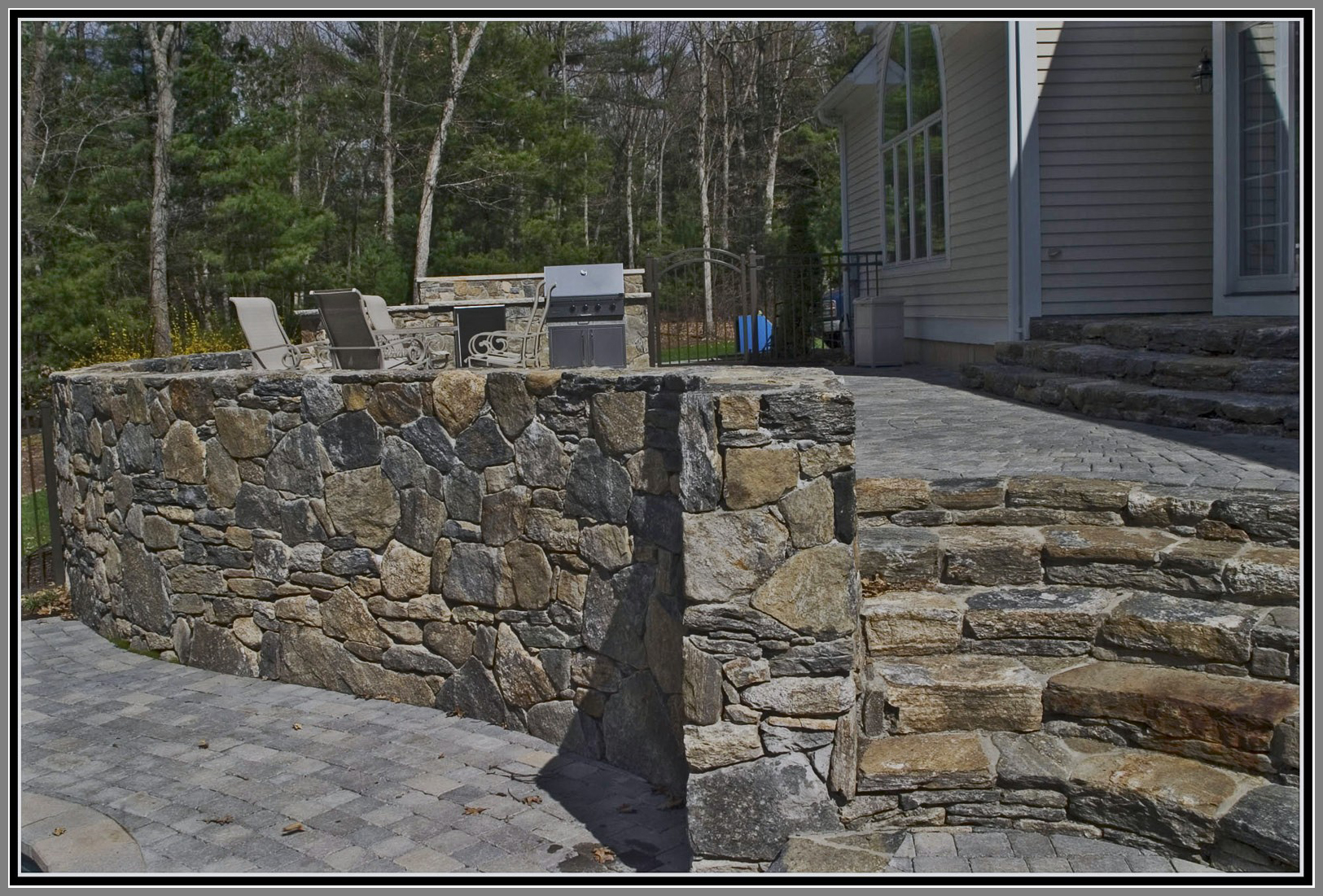 Field stone wall and steps by Artistic Outdoors