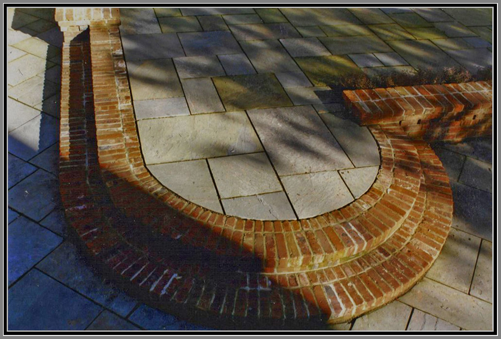 Blue stone patio and brick steps
