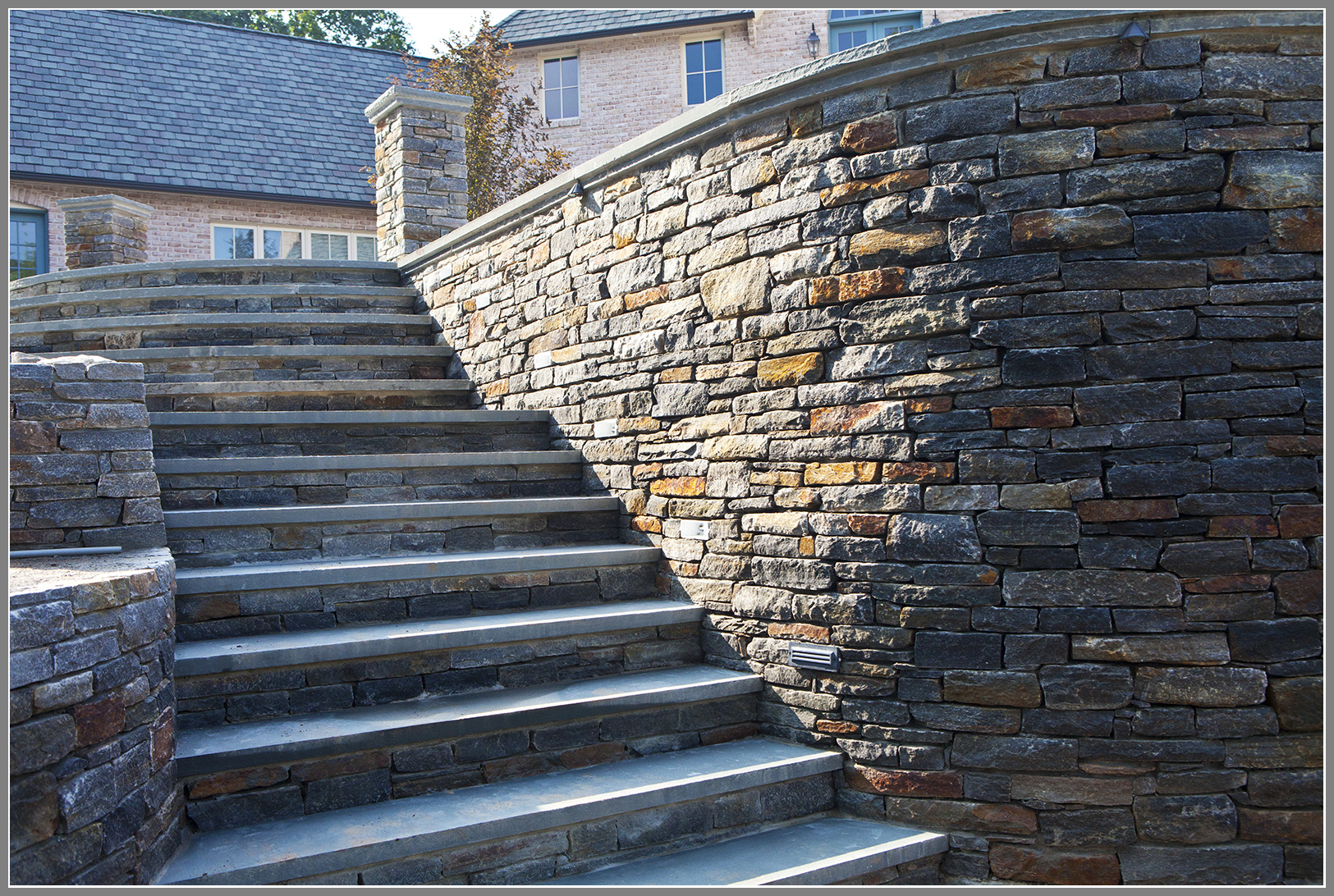 Stone wall and steps with bluestone cap