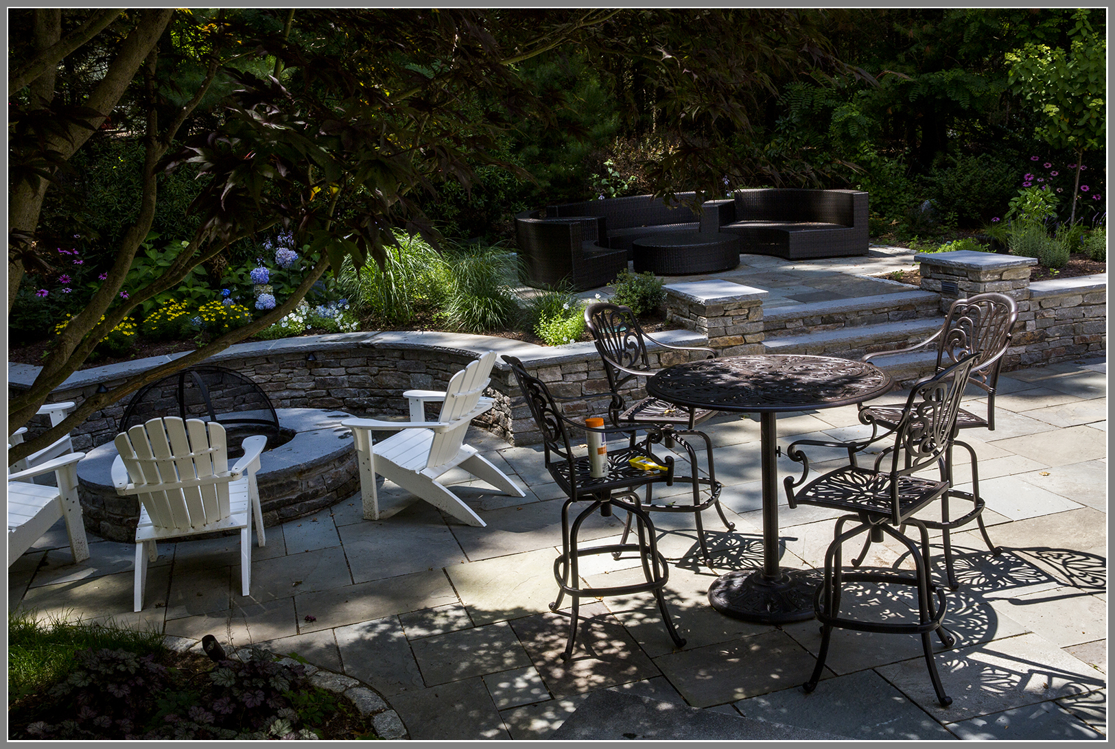 Fire pit and outdoor room by Artistic Outdoors
