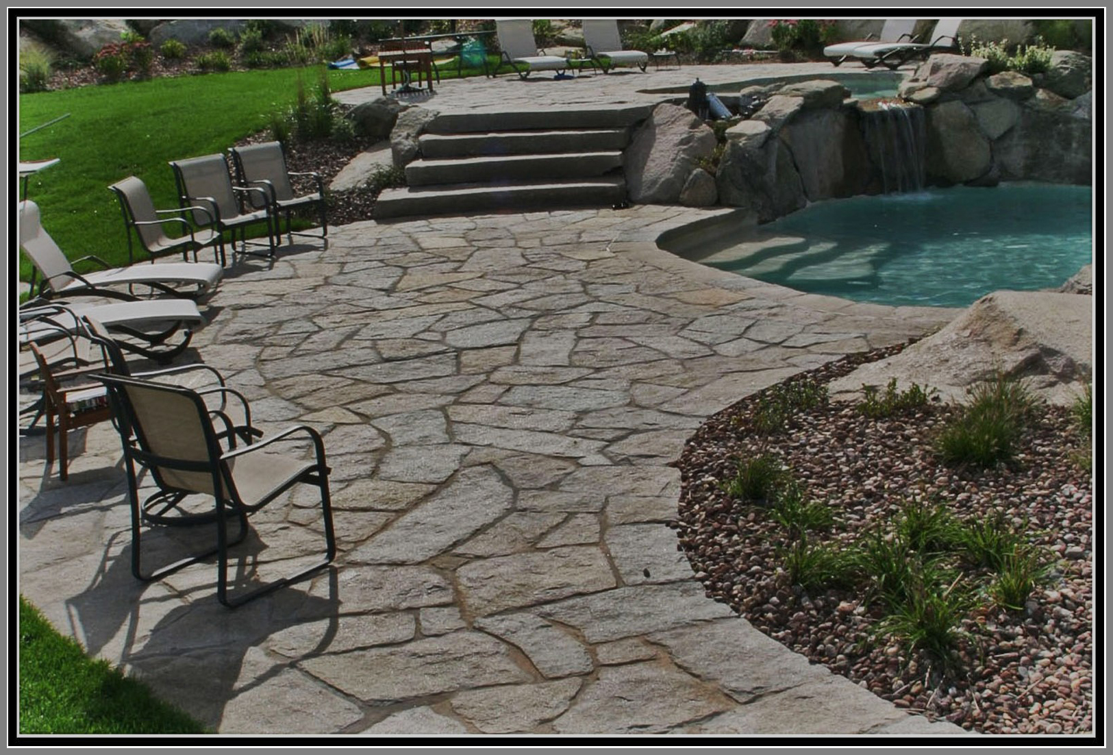 Flag stone granite patio and pool deck