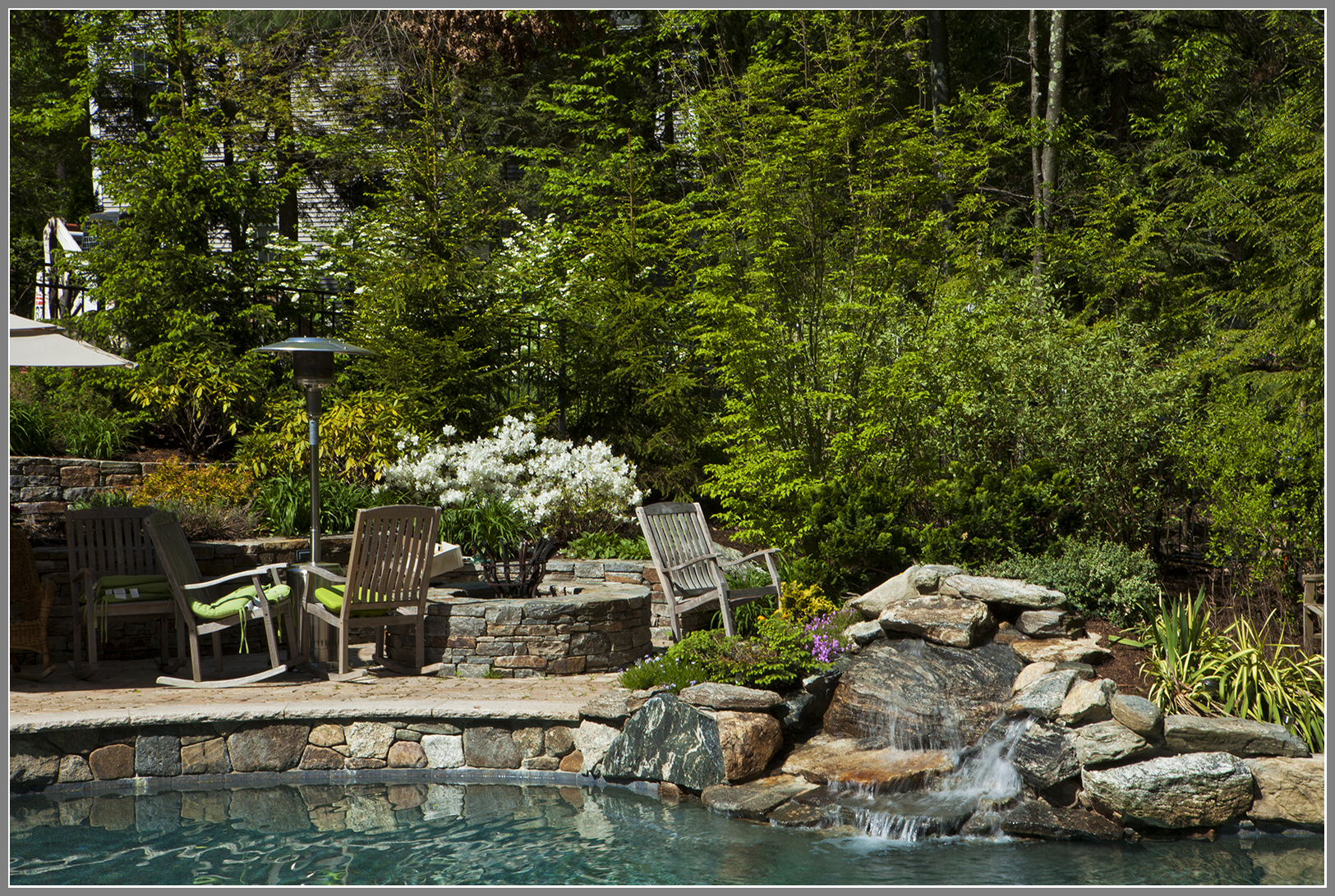 Waterfalls and fire pit by Artistic Outdoors
