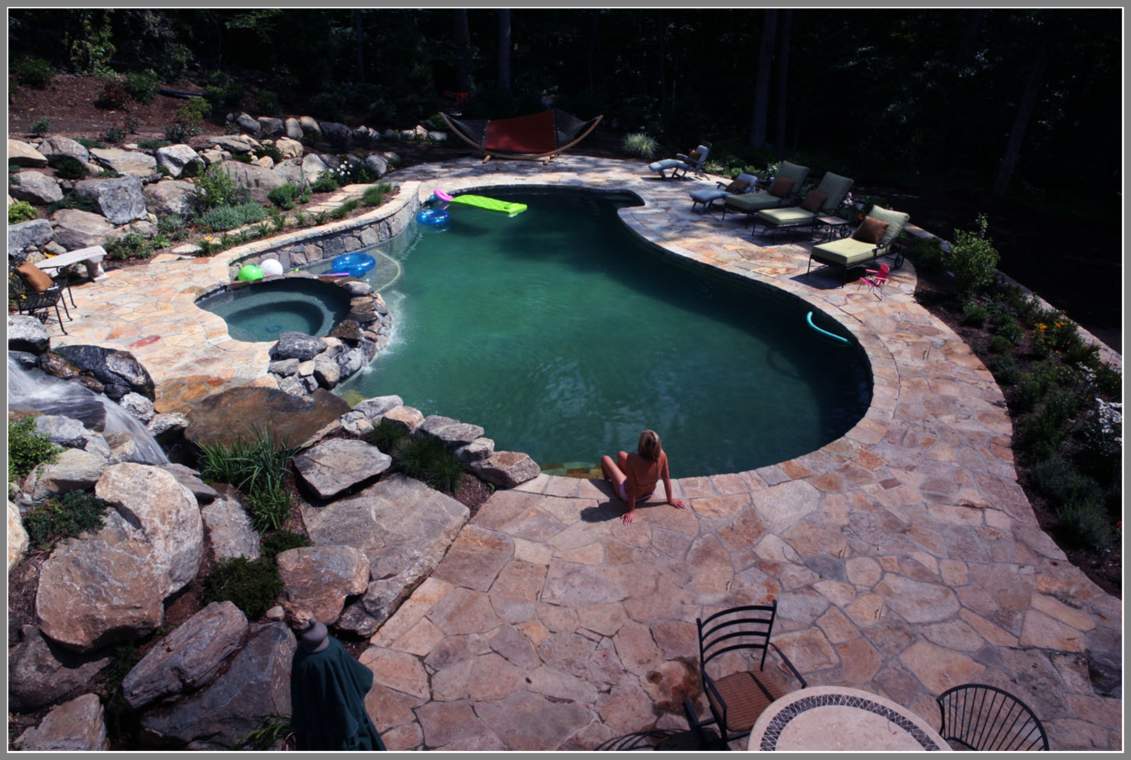 Stone pool deck by Artistic Outdoors