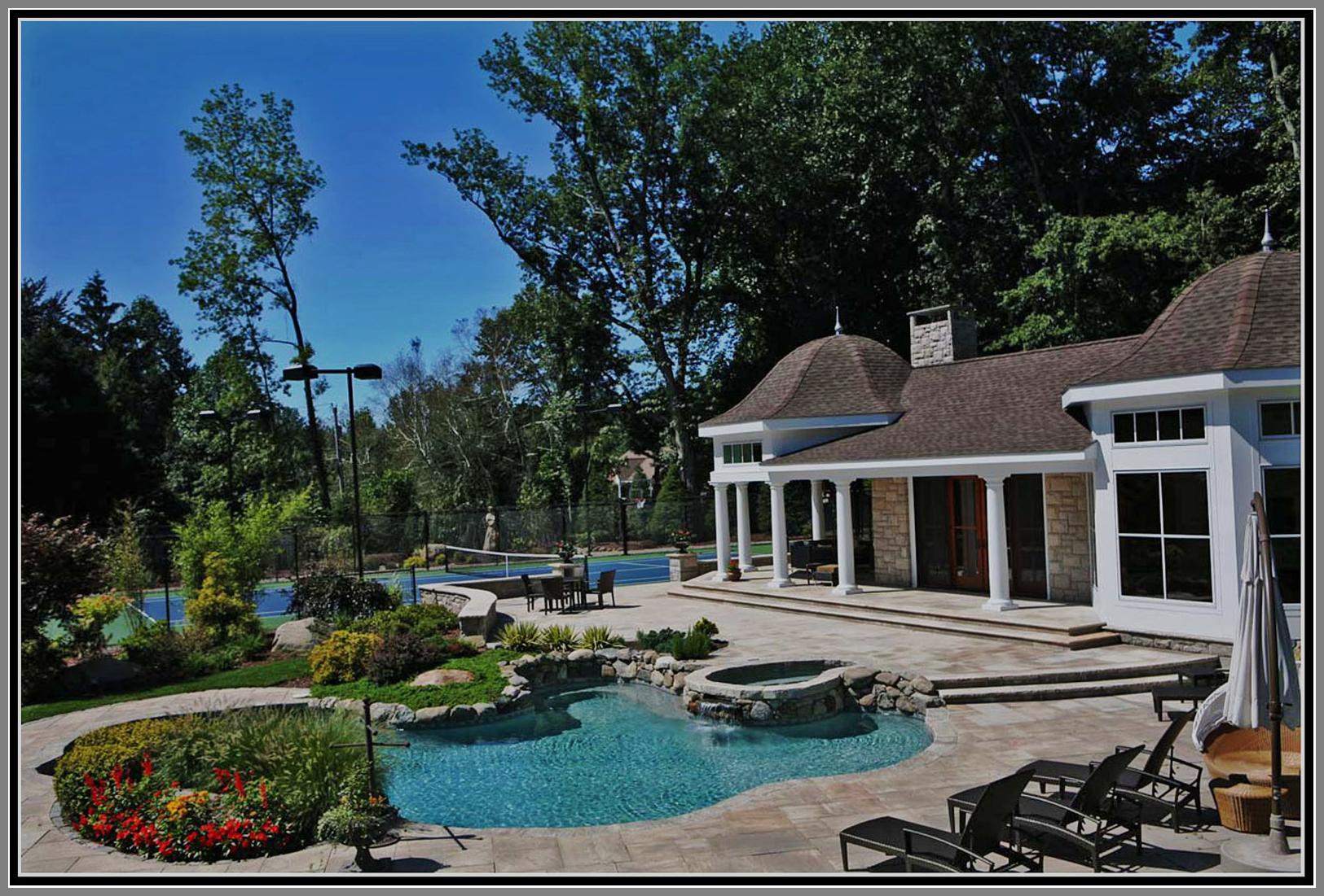Swimming pool, granite deck and pool house.