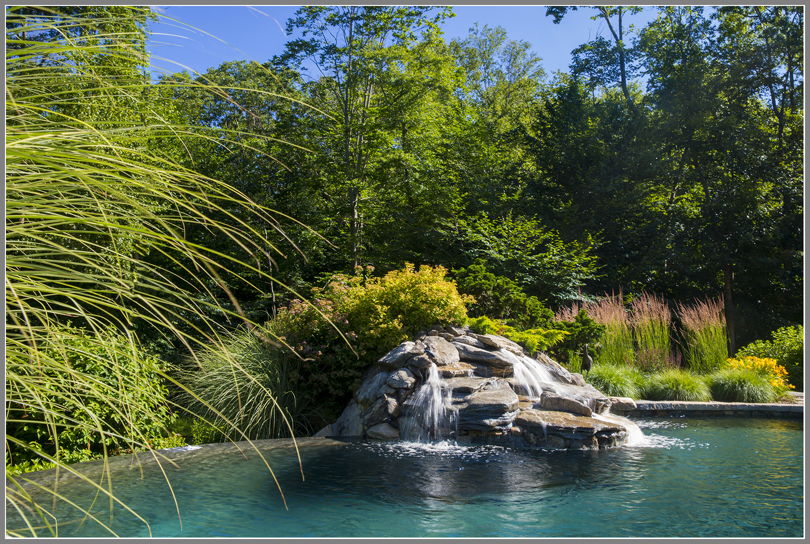 Infinity edge pool with waterfalls