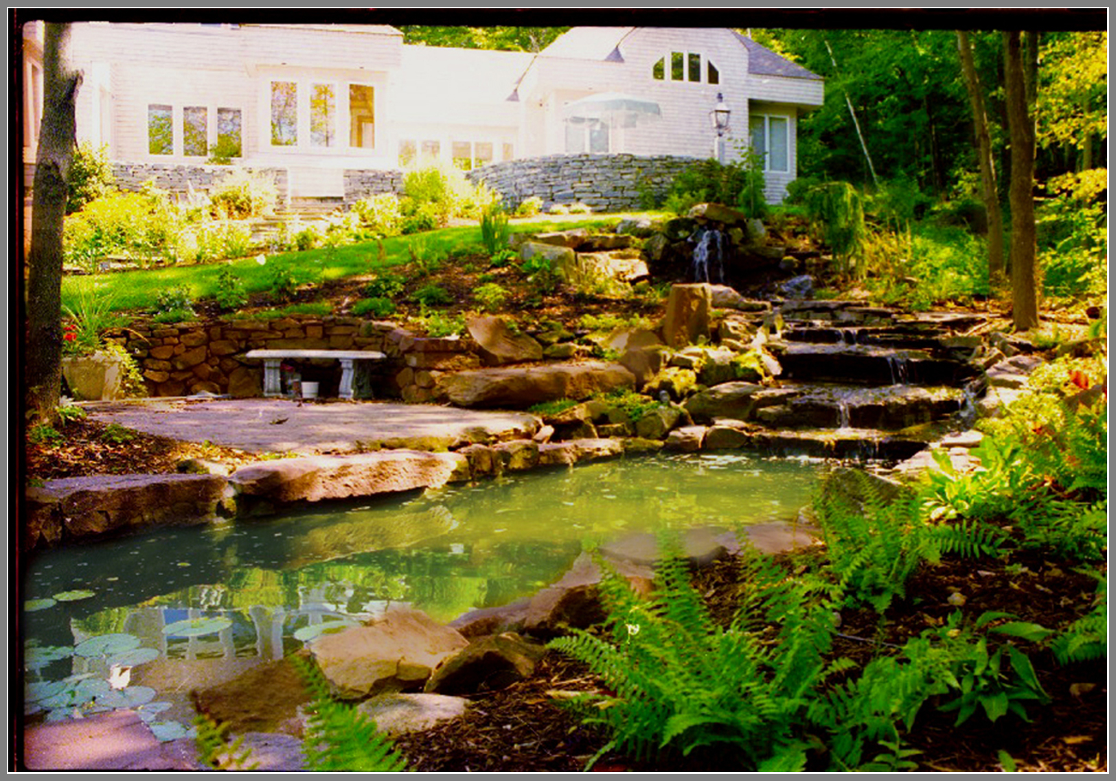 Waterfalls and pond by Artistic Outdoors