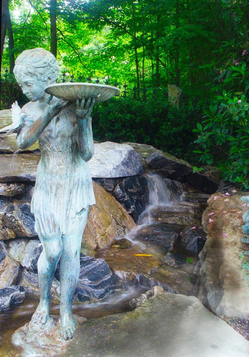 Bronze statue in water garden