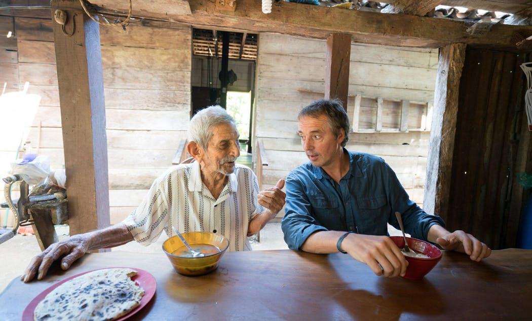 Dan Buettner and a centenarian in Costa Rica (Photo credit: David McLain, Special to the Star Tribune)