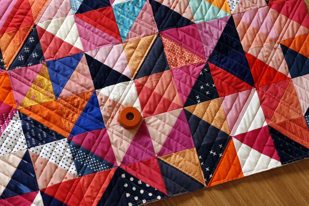 Custom quilting half square triangle quilt