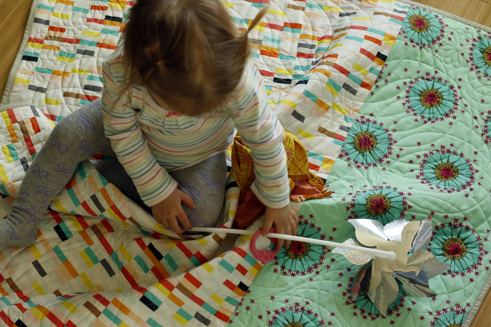 Rora on Wheel quilt back.jpg