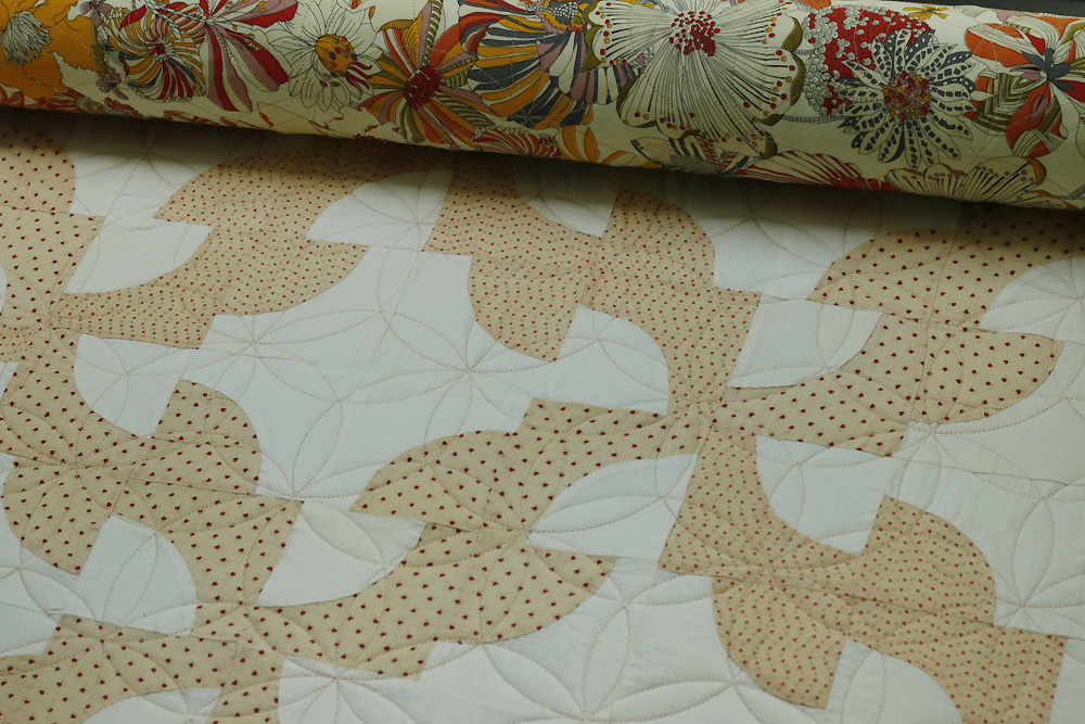 Vintage quilt with orange peel.jpg