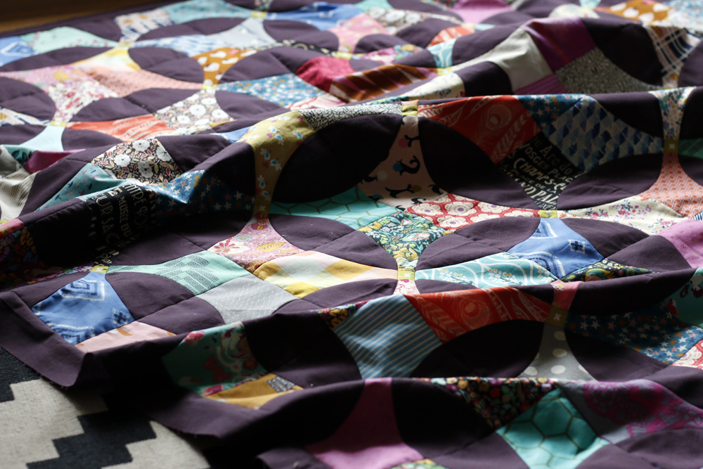a finished quilt top. Stitched in Color.jpg