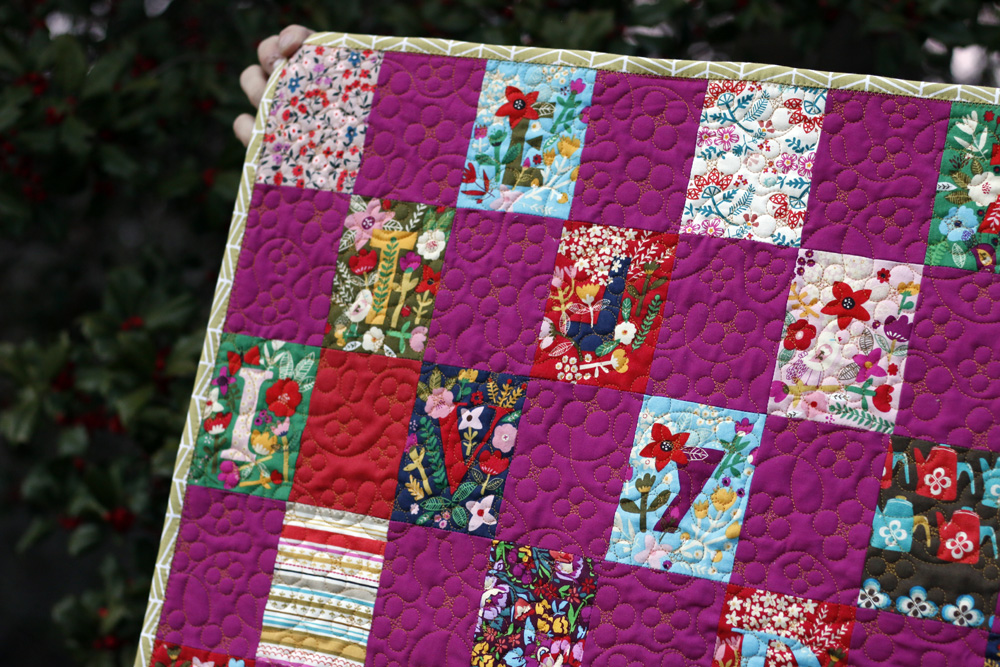 Bound baby quilt. Stitched in Color.jpg