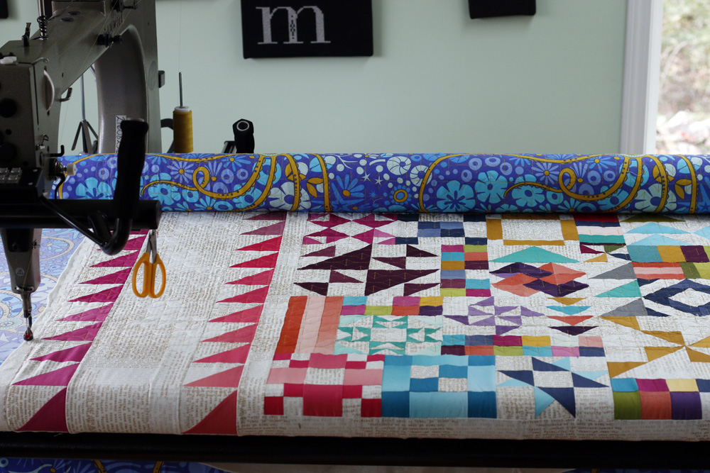 Naomi Grebe on longarm. Stitched in Color.jpg
