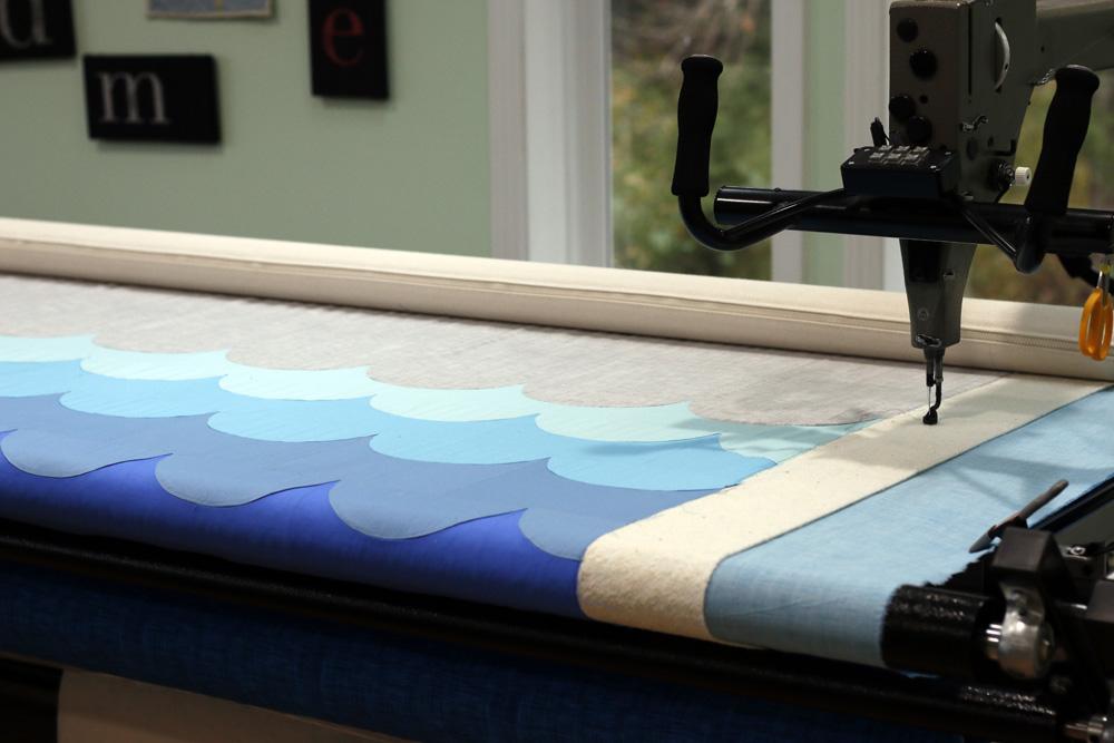 Wave quilt on longarm. StitchedinColor.jpg