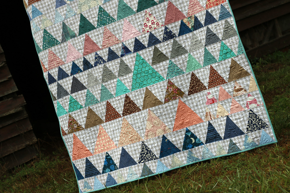 Triangle play quilt. Stitched in Color.jpg