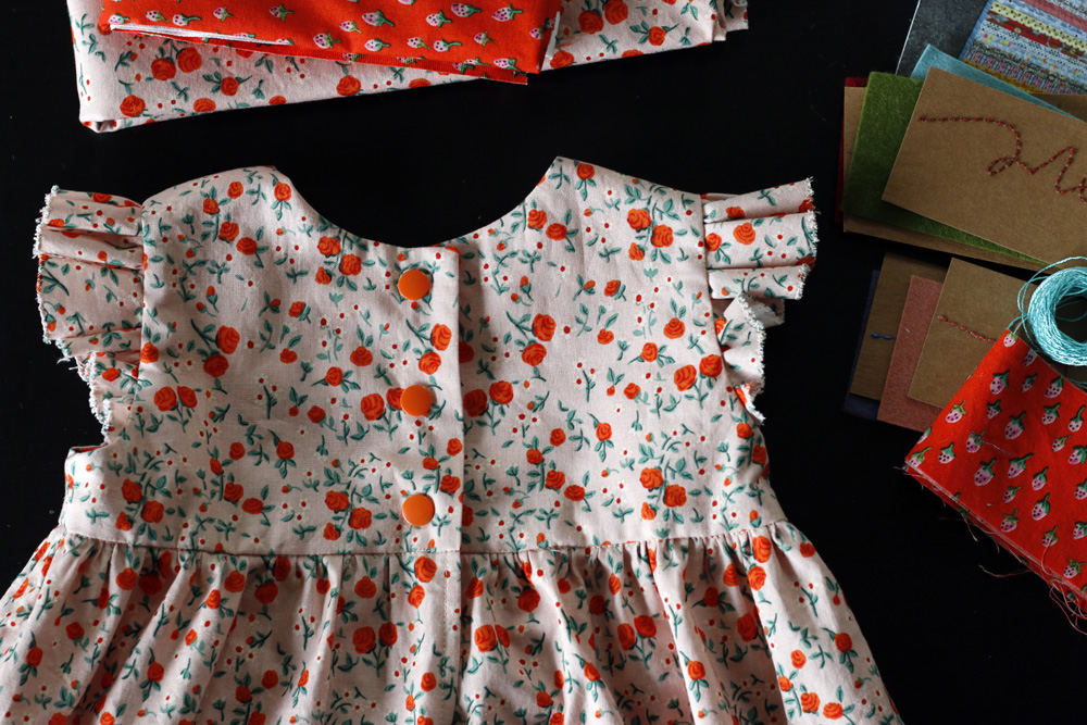 Snap closure geranium dress. Stitched in Color.jpg