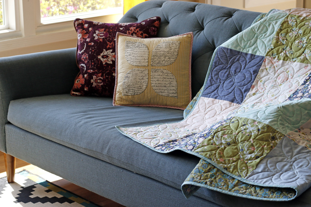 quilt on sofa. Stitched in Color.jpg