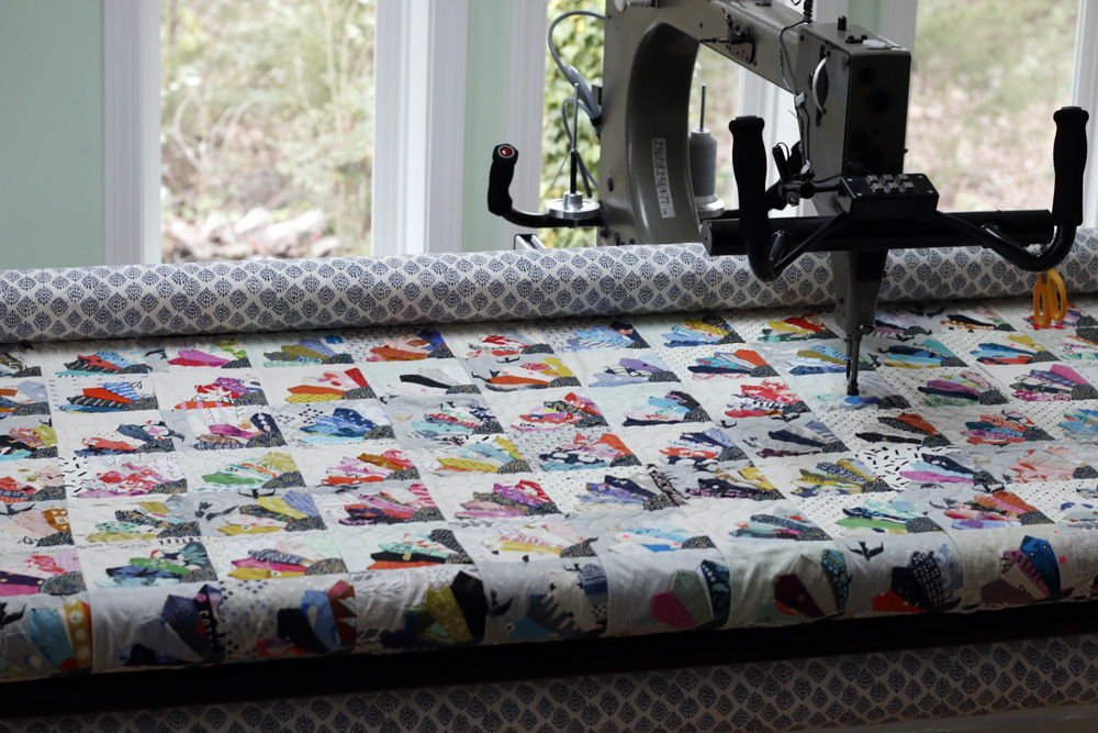scrap quilt on longarm. Stitched in Color.jpg