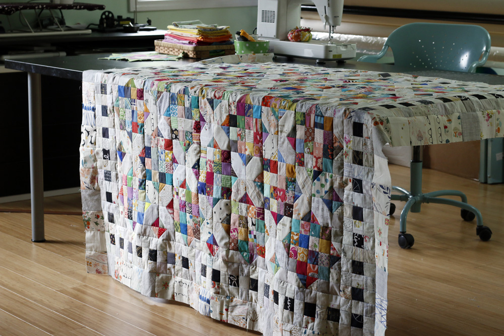 quilt top on my table. Stitched in Color.jpg
