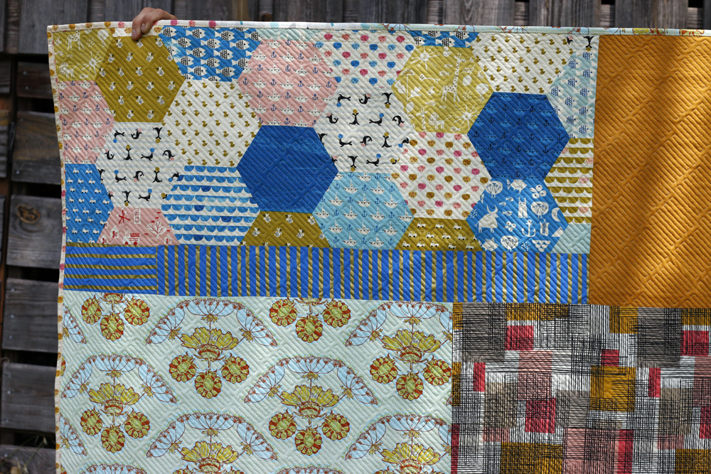 Scrappy quilt back. Stitched in Color.jpg