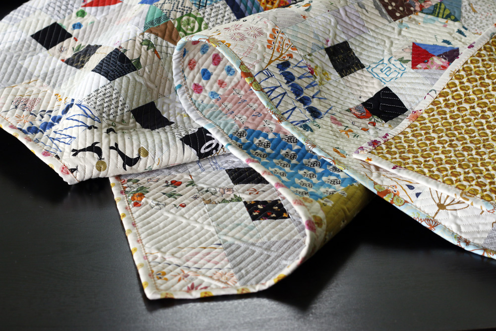 Crossroads quilt binding. Stitched in Color.jpg