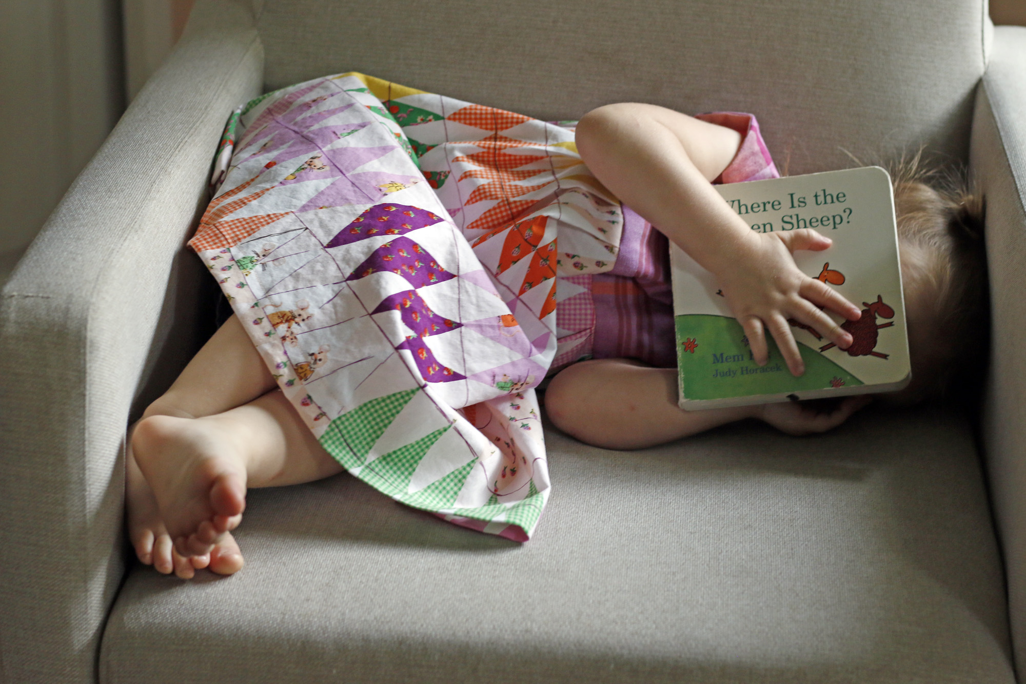 Elora Hiding with book. Stitched in Color.jpg