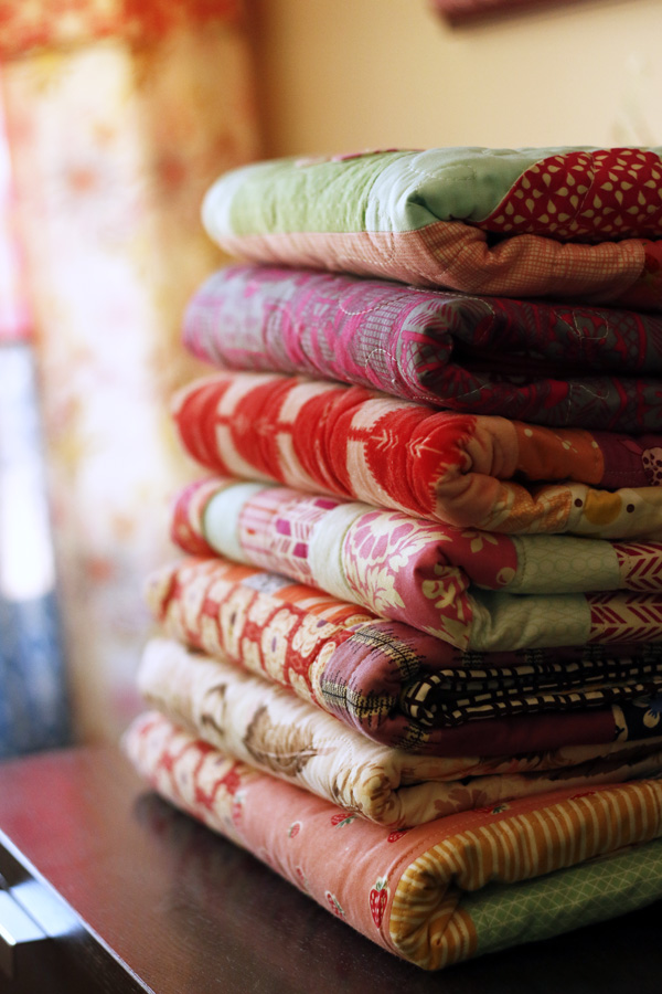 Stack of Heart quilts. Stitched in Color.jpg