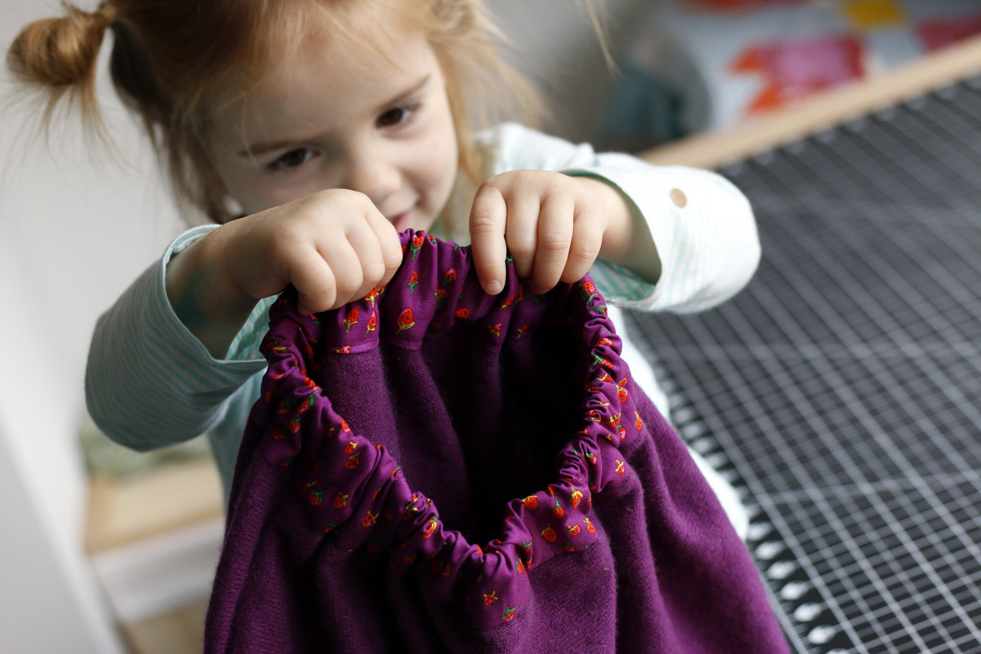 Elora holding skirt. Stitched in Color.jpg