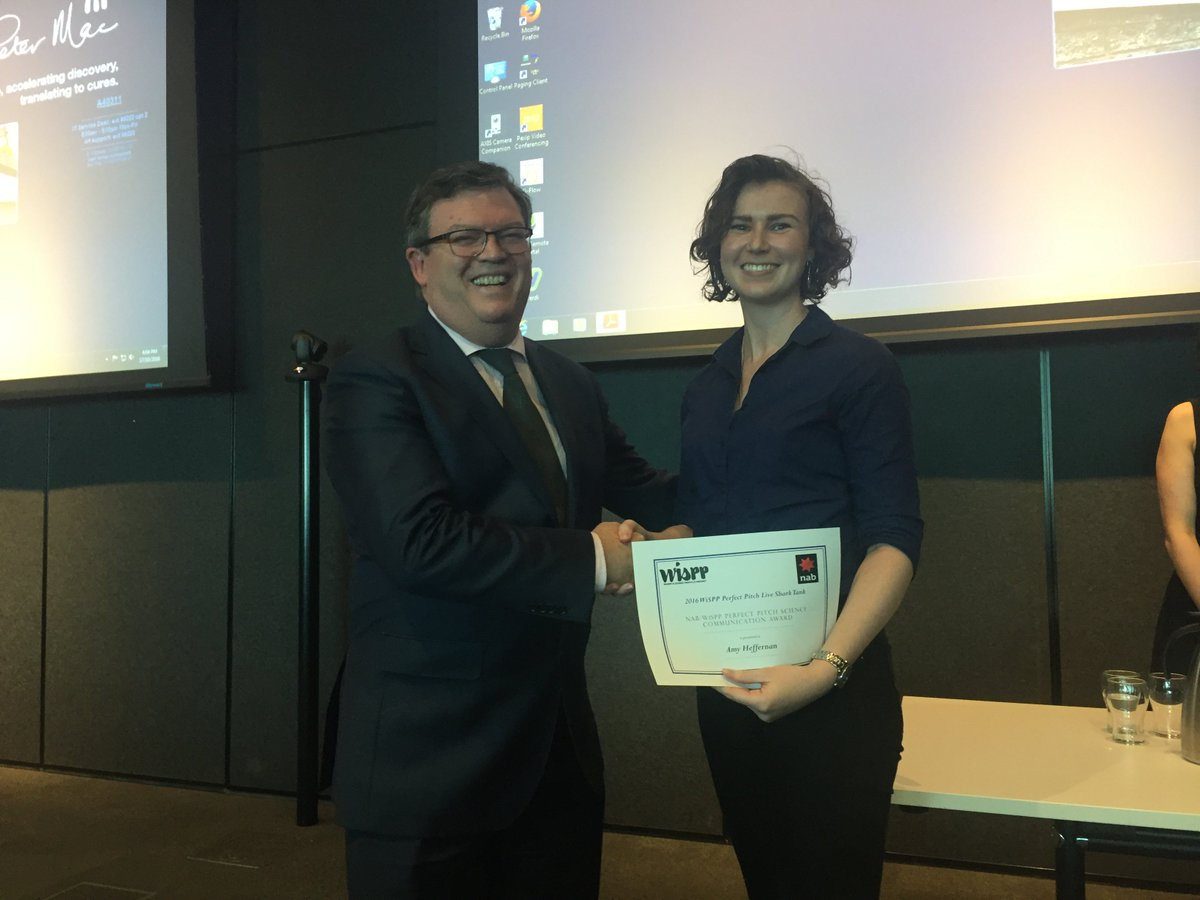Dr Amy Heffernan receives her award from Parliamentary Secretary for Medical Research, Frank McGuire.