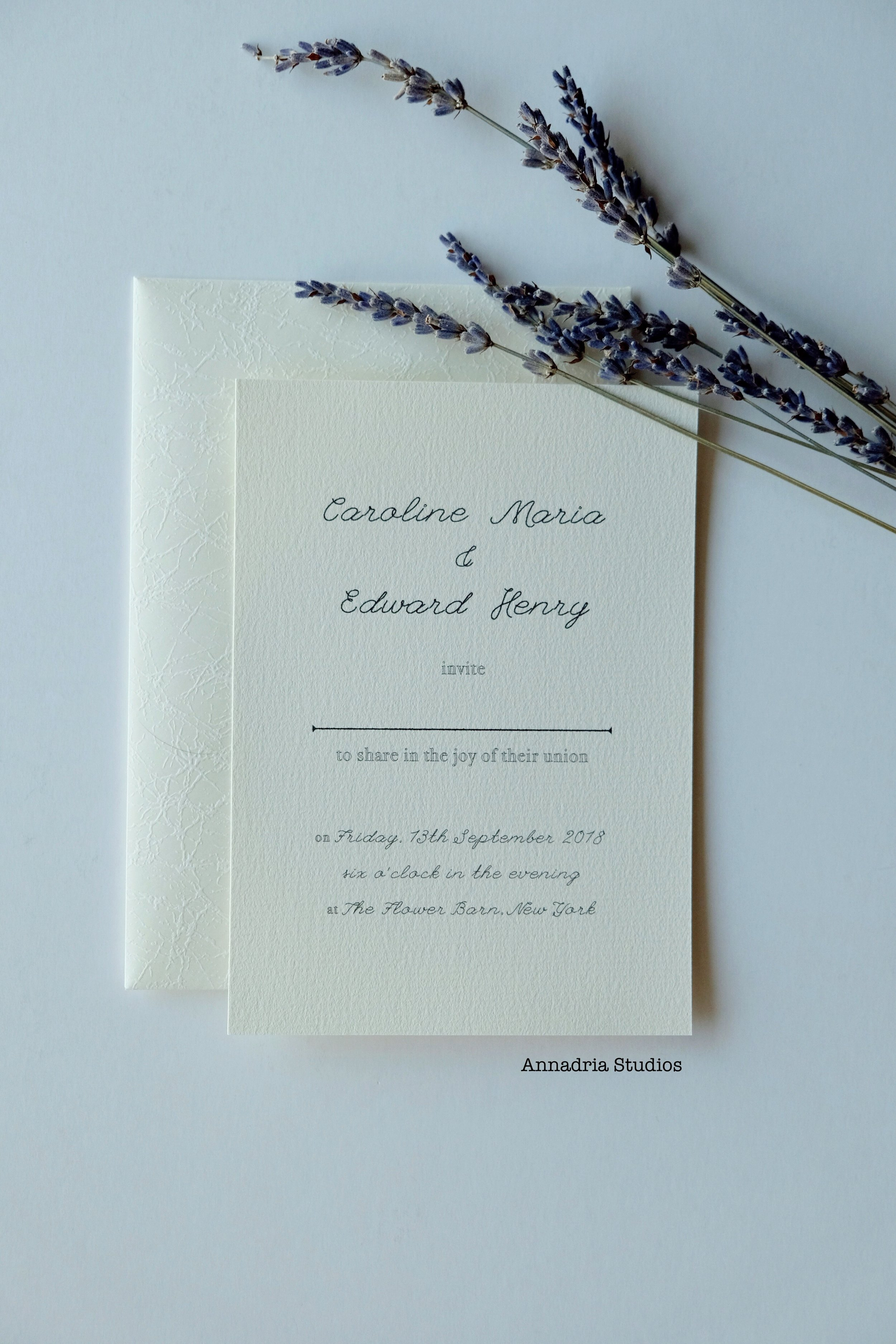 Invitations with guest names, designed by  Annadria Studios .