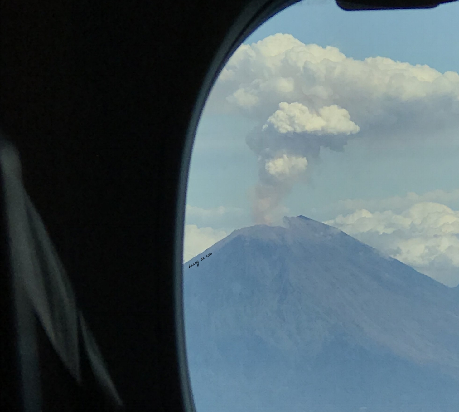 Mount Agung cooling off after an eruption, as seen from my airplane seat.