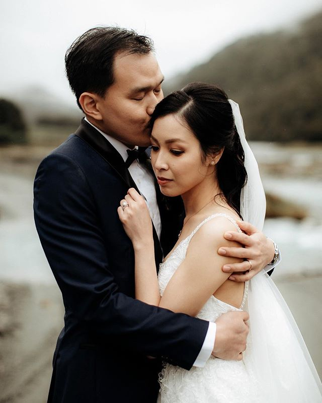 My new favourite photo of us. 10 degrees & in the rain.  #destinationweddings #nzweddings #glenorchy #weddingday