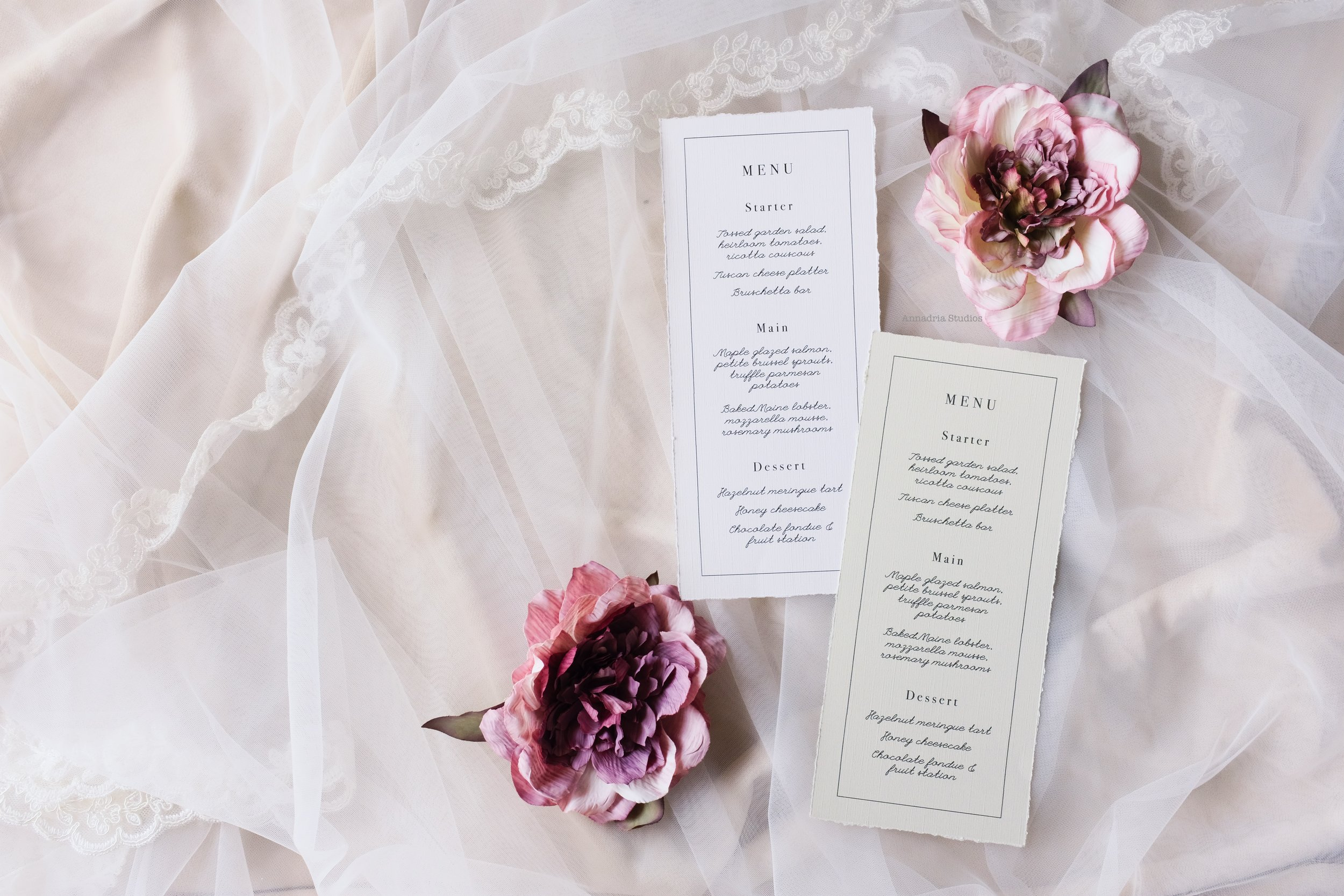 Deckle edge linen menu cards, exquisitely designed with hand-torn edges.