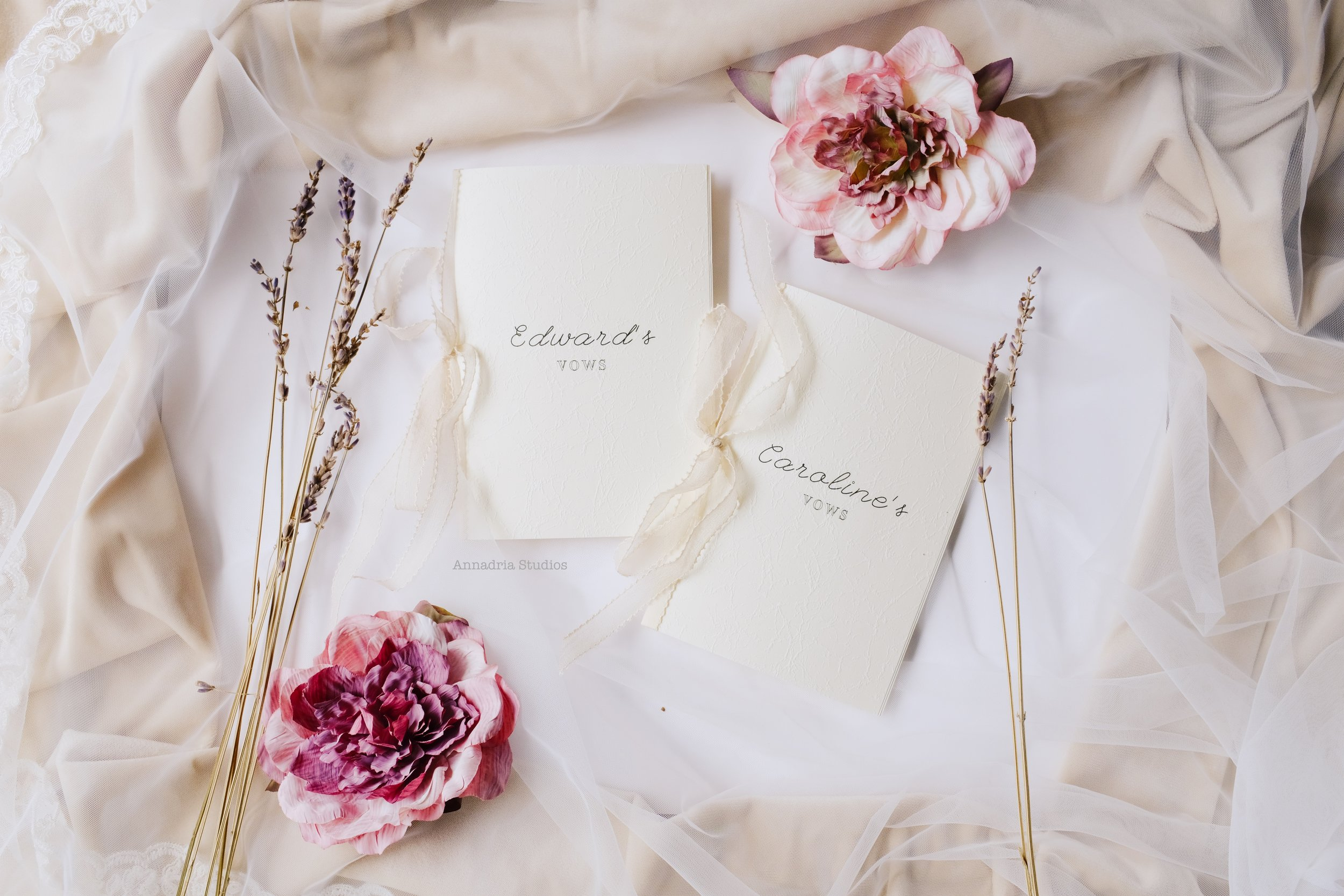 Handmade vow booklets, on embossed Japanese paper and bound with delicate silk ribbons.