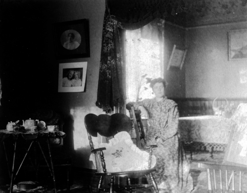 The parlour of the parsonage of the Centennial Methodist Church; 63 David Street, Victoria; woman unidentified [ca. 1895] / British Columbia Archives / C-06607