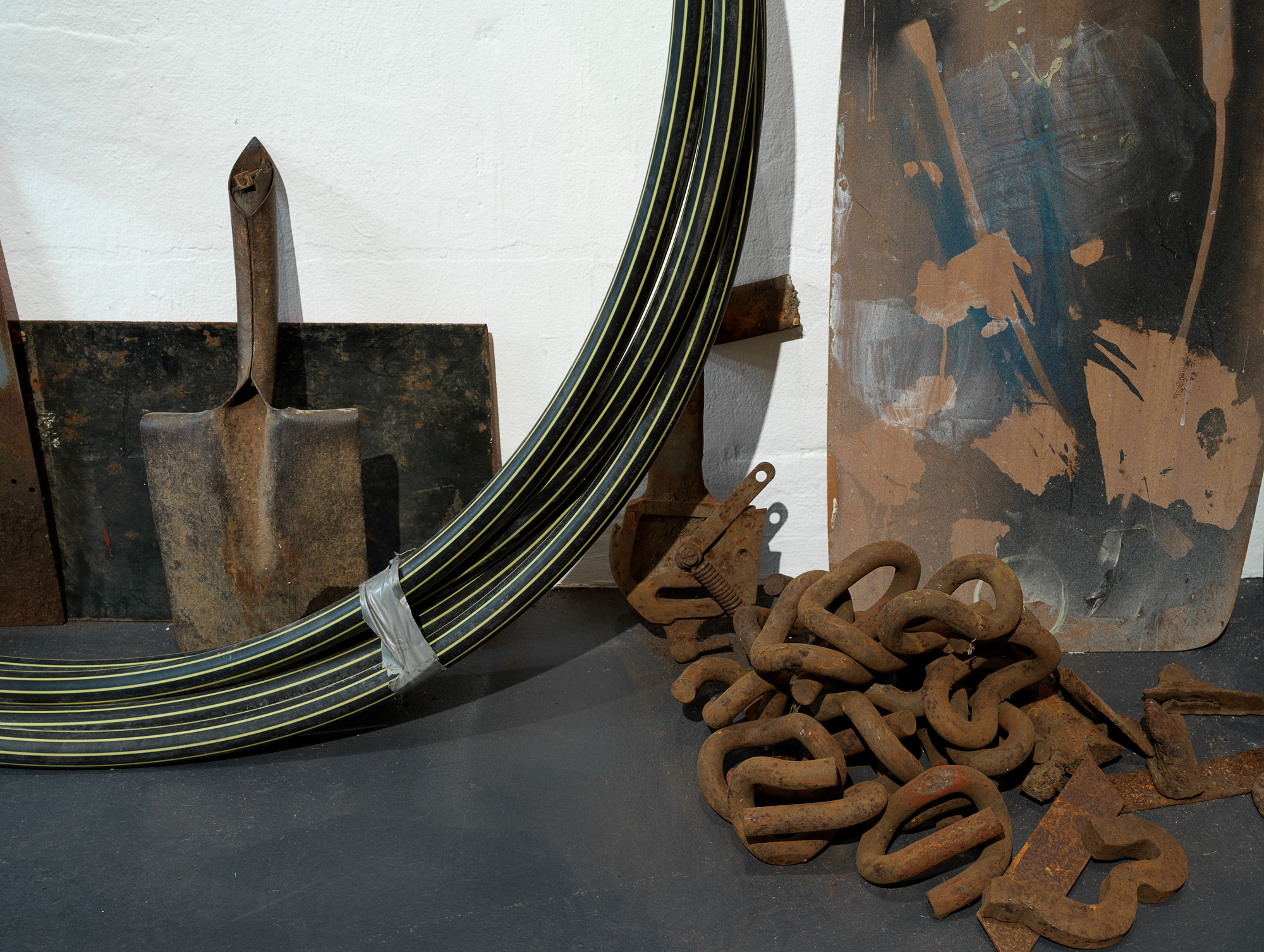 Precious Things  (detail), 2018  Metal braces, metal scoreboard numbers, length of hessian, hessian bags (various), fly wire screens, mooring rope, aged tarpaulin, metal rod with synthetic rope attached, wooden trellis, pieces of wood, awning, shovel head, copper piping, rubber gloves, windmill blades, roll of used ram board, cardboard pieces, metal frames (oven), plastic gas piping, plastic hazard stand, plastic polythene sheets, plywood, electronic component (oven), wooden stool, rusted pieces of piping, tree bark, seed pods, metal signs, telegraph insulators, local rocks, lapis lazuli, plastic (clear and opaque), studio leftovers/experiments, paint, bitumen rubber, tape, nails.  300 x 300 x 280 cm  Photograph Grant Hancock