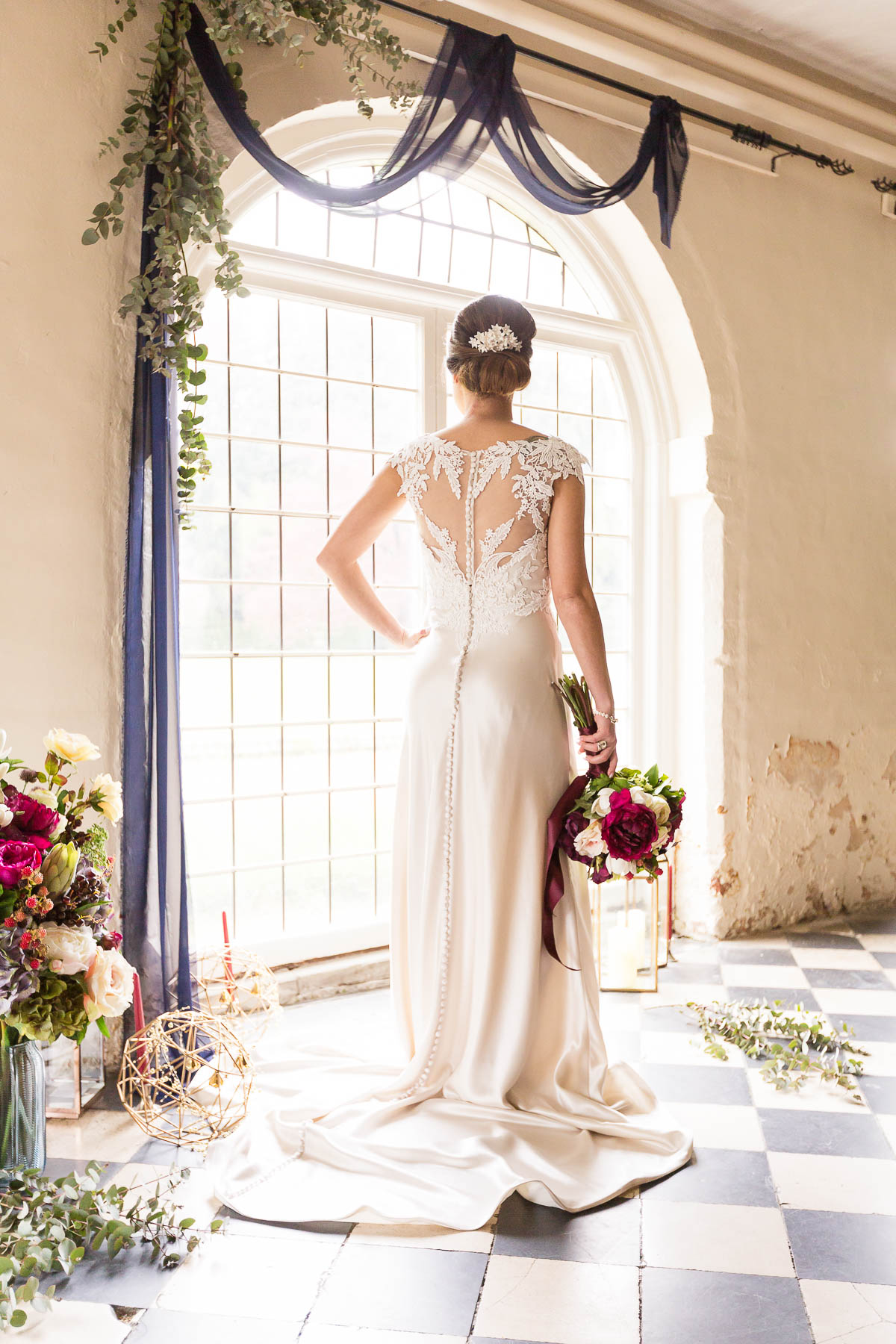 Red berry and navy wedding inspiration wedding dress and flowers