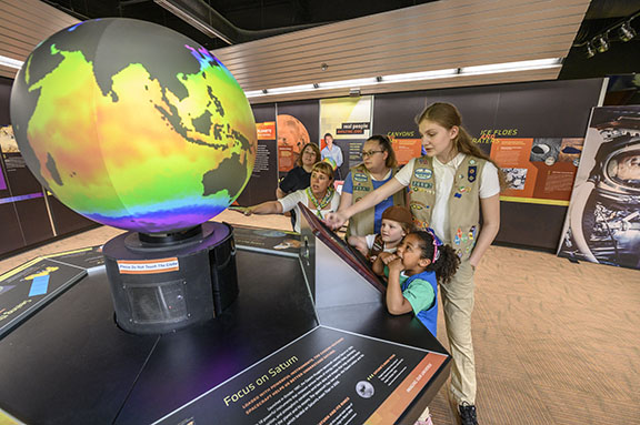 Girl Scouts of all ages enjoyed a visit to the McAuliffe-Shepard Discovery Center, where they could interact with the many displays. (GSGWM/Alan Macrae photo - with thanks to the McAuliffe-Shepard Discovery Center)