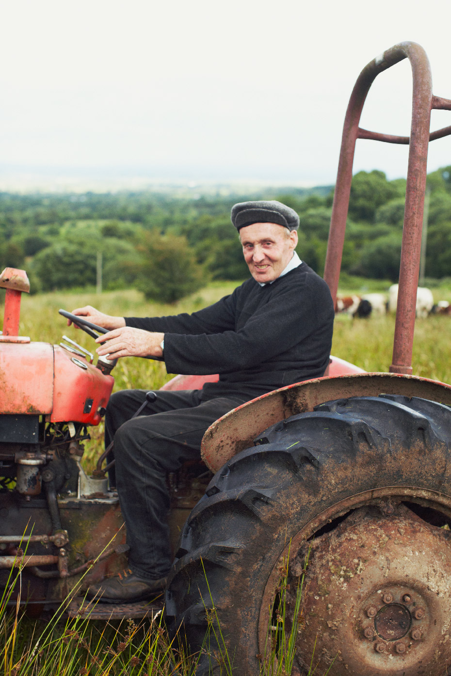 Stacey Van Berkel Photography I Irish farmer on red tractor in field I Donegal, Ireland