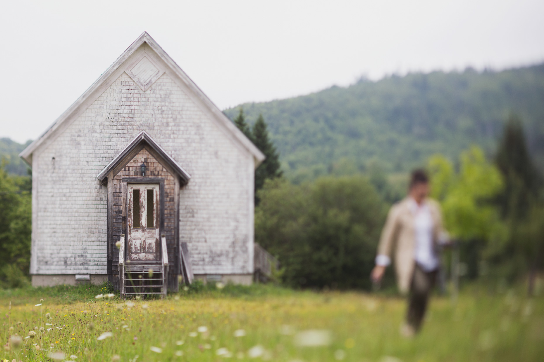 Stacey Van Berkel Photography I Old schoolhouse with woman walking away I Cape Breton, Canada