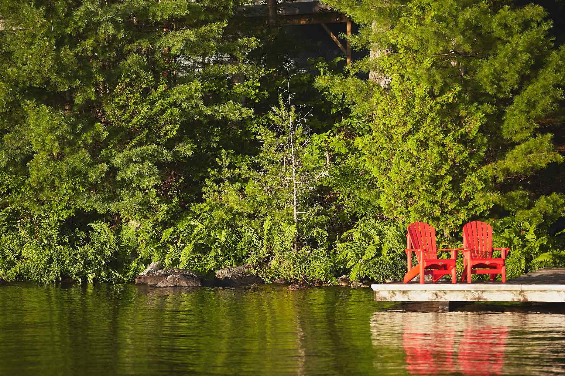 Stacey Van Berkel Photography I two red adirondack chairs on dock I Muskoka, Ontario, Canada