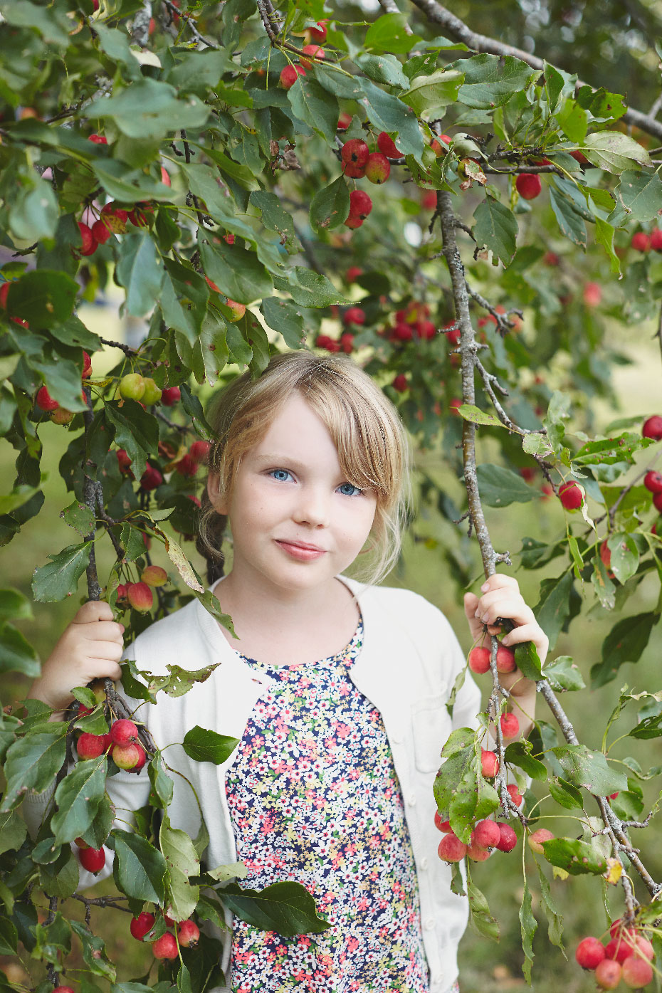 Stacey Van Berkel Photography I Young blonde girl standing under a crabapple tree I Stewiacke, Nova Scotia I Canadian Living Magazine
